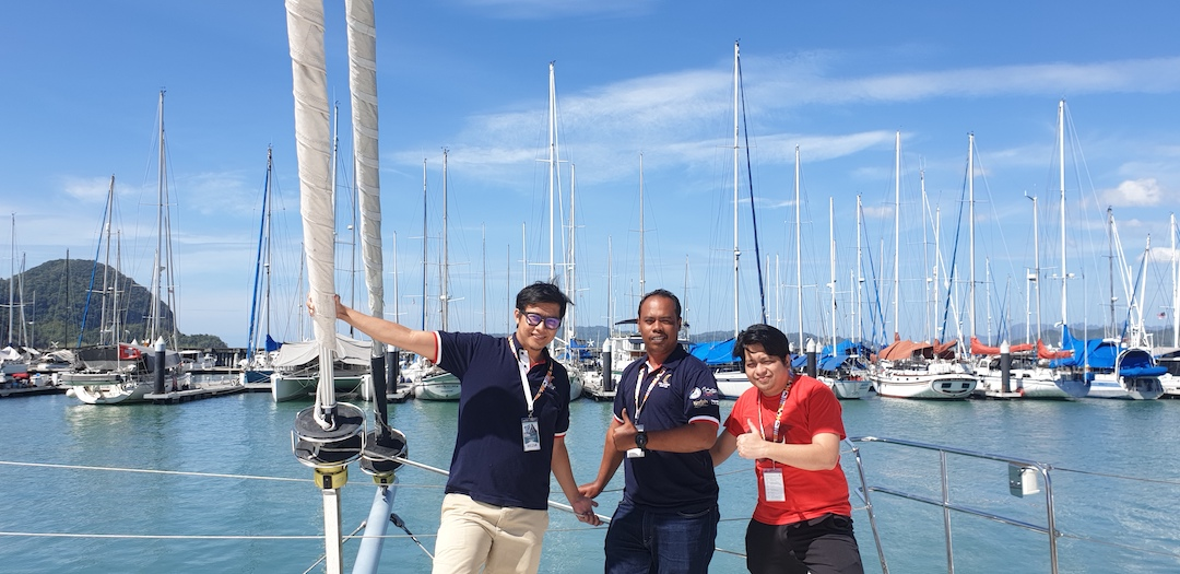 This year's Stampede RLIR crew featuring (from left to right) FEDs Sani and Iwan and Designer Saiful aboard one of RLYC's yachts, the Manta Blue.